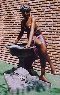 Woman Sitting on Fountain
