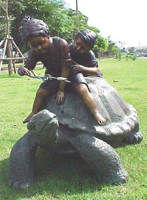 Two Boys Riding Turtle